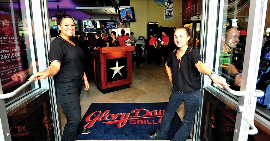 Glory Days Grill employees welcoming diners to the restaurant